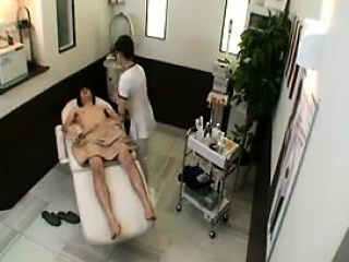 Cute Asian babe massages a..