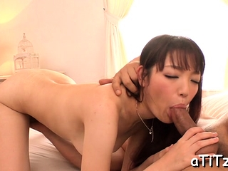 Asian strokes her own boobs..