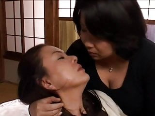 Middle-Aged Lesbians Kissing..