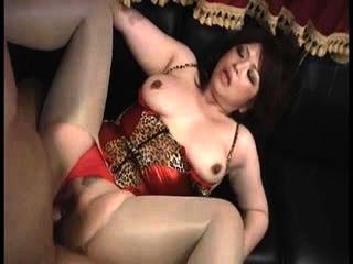Busty Asian MILF in a bikini..
